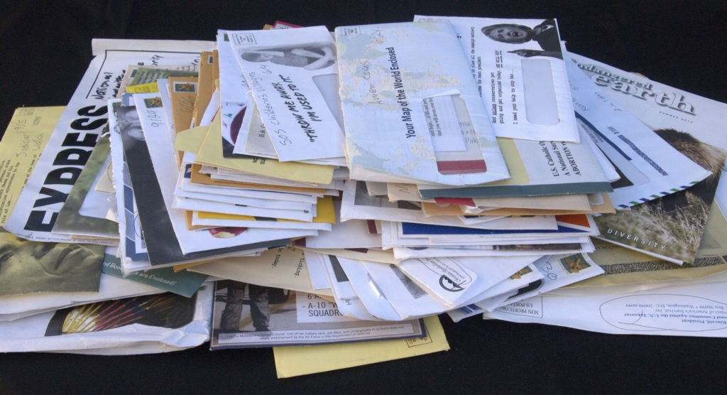 Pile of junk mail needing decluttering