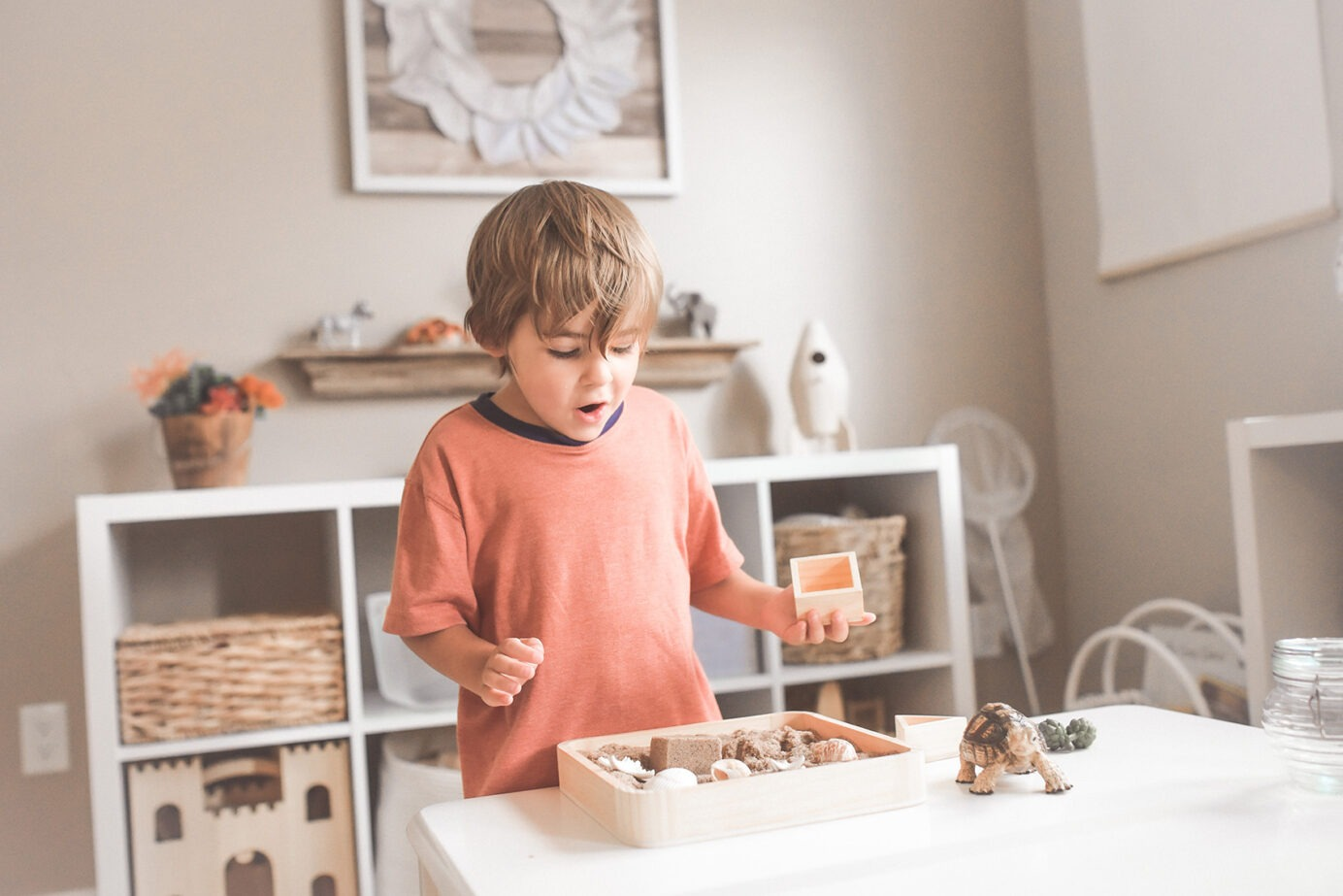 Child playing in tidy home